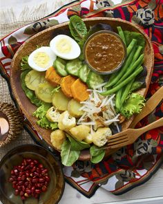 For INDONESIAN ingredients including those in GADO GADO an Indonesian salad which consists mostly of boiled or blanched vegetables accompanied by a sweet and spicy peanut dressing, similar to but not as rich as satay sauce, visit the GROCERY GUIDE in the All About Cuisines web site.#Indonesian Food #Indonesian Recipes