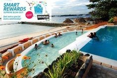 Fun-Filled Samal, Davao Vacation with Accommodations at Bluejaz Resort and Waterpark, Zipline, and Whole-Day Use of Giant Slide: Choose One or Two Nights http://www.beeconomic.com.ph/deals/groupon-travel/Bluejaz-Beach-Resort-and-Waterpark/716869187