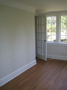 Pale Oak by Benjamin Moore- living room wall maybe.... Only if the foyer, kitchen, stairs and hallway are this too.... *sigh* to have color or to be neutral... That's my question!!