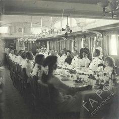 Alexandra Feodorovna, Olga Nikolaevna and Anastasia having dinner with officers of the Standart, 1911