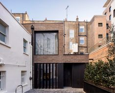Pivoting louvres conceal windows of mews house by Belsize Architects