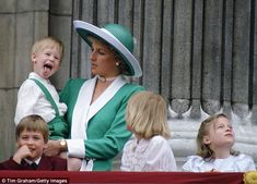 Much loved: William and Harry with their mother Princess Diana on the Buckingham Palace ba...