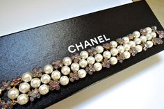 Chanel 96P Pâte de verre pearl bracelet. Purple pink glass flowers braided with glass Baroque pearls sumptuously, making this haute couture piece a symmetric and luxurious beautiful look. Purchased new never worn with little signs of age on hardware. ✿*゚ VINTAGE-FRANCE-DE-COUTURE by sincere_international