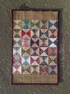 Hourglass. Interesting quilting.