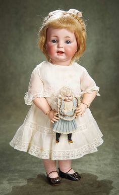 German antique bisque doll & her dolly.