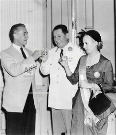 Eva Peron, wife of Argentine President Juan Peron, received Decoration Aztec Eagle from the Mexican government at presentation ceremony at Government House, Casa Rosada, Argentina, March 19, 1951. Mexican Senator Antonio Bermudez, left, proposed toast to President Juan Peron and Eva Peron. (AP Photo)