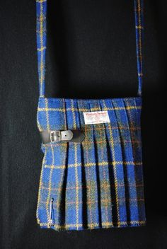 Stunning original shoulder bags in the shape of a kilt, made from pure Harris Tweed. The bags are made in small quantities by Fiona Mitchell in her workshop on Orkney. To avoid misunderstandings / embarassment the tartans used are mostly fashion tartans, not the tartans of a particular clan!