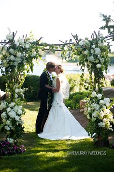 Stoneblossom Florals' branches arbor designed with bursts of white flowers