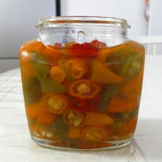 Homemade recipe for mouth-watering hot chilly pickles! Fermentation Recipes, Canning Recipes, Chilli Recipes, Sauce Recipes, Keto Recipes, Fresco, Green Chilli Sauce, Mustard Pickles, Pickled Eggs