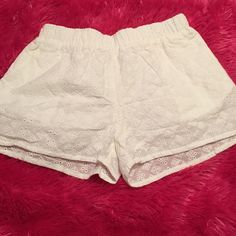 Nice pair of shorts Nice pair of white shorts with a crocheted like pattern with pockets Shorts