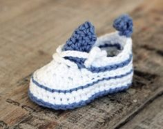 Tri-Colored Sneaker Pattern This is a listing for 2 PDF files containing the **Pattern** to this adorable pair of Baby Sneakers! Here is the listing for the pattern to the Tri-colored Hat and Sneaker Set: https://www.etsy.com/listing/474705659/ Pattern Info ************* Sizes: Newborn, 0-3 Mos, 3-6 Mos, 6-12 Mos and 12- 18 Mos. Level of difficulty: Beginner to intermediate: Written in US terms. I love pictures so I include many of them along with detailed explan...