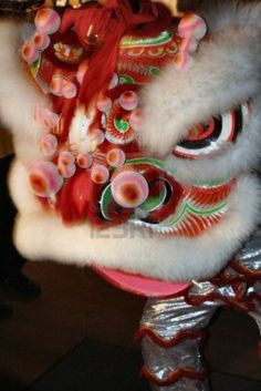 Shrouded in a dragon head costume, a young man re-enacts a traditional Chinese New Year dance during festivities in the University City neighborhood of Philadelphia PA.