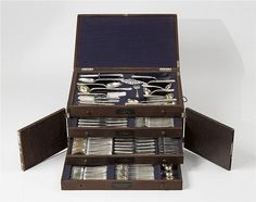 A large Fabergé parcel gilt silver cutlery set. Moscow, mark