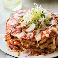 Stacked Chicken Enchiladas | From: sunset.com | Though the sauce for this handsome dish tastes complex, it's made with canned chile sauce doctored up with sweet spices, raisins, pine nuts, and smoky chipotle chiles. Prep and Cook Time: about 1 hour. Notes: For a hotter sauce, add more chipotles and adobo sauce to the chicken mixture. | Via: myrecipes.com