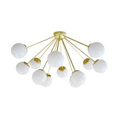 A sleek and sophisticated Sputnik-style lighting fixture, the Glittering Galaxy Chandelier will elevate an entryway or dining area with its ultra-modern silhouette. This chic chandelier is handmade fro...  Find the Glittering Galaxy Chandelier, as seen in the All Signs Point to Mid-Century Collection at http://dotandbo.com/collections/all-signs-point-to-mcm?utm_source=pinterest&utm_medium=organic&db_sku=106826