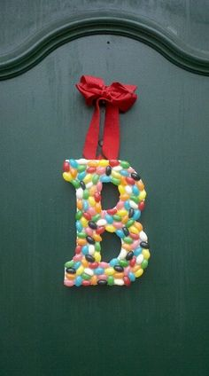 So easy and so cute for Spring! Buy a paper mache or wooden letter from the Craft store, and apply jelly beans and ribbon using a hot glue gun!