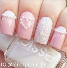 Pastel pink and pearl nails