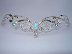 Blue Fire Bridal Circlet is pervfect for wearing a unique, and hand made Sterling Silver Bridal Tiara. A treasured Silver Headpiece for your Celtic Fantasy Magic, Bijoux Fil Aluminium, Bridal Tiara, Bridal Crown, Wedding Veils, Bridal Headpieces, Wedding Hair, Celtic Wedding, Elvish