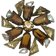 Simply stunning vintage high end designer rhinestone saphiret brooch. The brooch has  a bail on the reverse so that it can be worn as a pendant also.