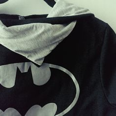 """Batman Black and Gray Cowl Neck Hoodie Batman hoodie with slouchy cowl neck collar. Labeled size L, but looks like it would fit a M. Pease check your measurements. Length 25"""", Bust 20"""", Sleeve 28"""" (long for slouchy fit). Very soft inside. Material is a little stiff on the exterior, but should soften after a few washes. Tops Sweatshirts & Hoodies"""