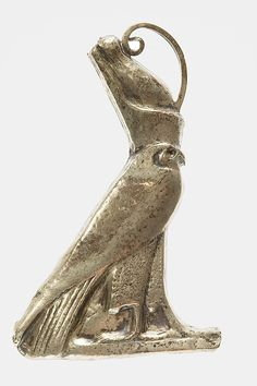 Hawk Pendant  Period:     Late Middle Kingdom–Second Intermediate Period Dynasty:     Dynasty 12, late–17 Date:     ca. 1850–1550 B.C. Geography:     From Egypt, Upper Egypt; Thebes, MMA Cemetery 800, Tomb MMA 840, pit in portico, MMA 1912–1913 Medium:     Silver rich in gold (electrum) over plaster