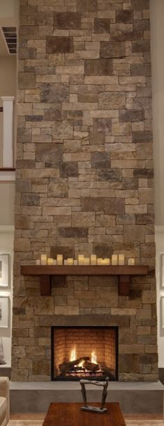 fireplace. Like the stone and wood mantel.