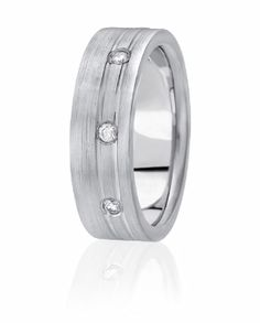 Three Diamonds Are Set Off Center Flushly To Create A Wedding Band With Some Designer Flair. Available In Seven Different Finishes
