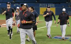 Rajai Davis leads a line of Cleveland Indians jogging before an ALCS playoff game 5 between the Cleveland Indians and the Toronto Blue Jays played at Rogers Center in Toronto on Wed , Oct. 19, 2016. The Indians won 3-0  and are going to the World Series (Thomas Ondrey/The Plain Dealer)