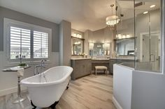 Traditional Master Bathroom with Flat panel cabinets, Hardwood floors, Complex marble counters, Rain Shower Head, Wainscoting