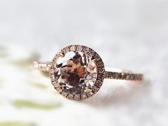 """InOurStar,to help more people find beautiful ways to say :I love you"""" with a gift of fine jewelry.    Round Cut Morganite Ring with a pave halo. A"""