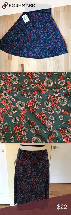 Lularoe Azure Skirt XS Lularoe Azure Skirt - Floral print (Dark teal back ground with purple and red flowers, NWT. Super versatile! Can be used as skirt or strapless top. Soft and airy 🛍🛍🛍 LuLaRoe Skirts Midi