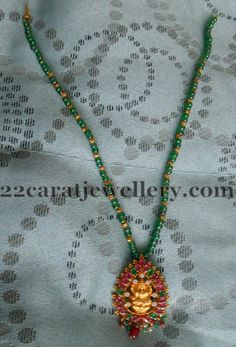 Jewellery Designs: Green Beads Set with Simple Locket