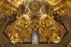 Cardiff Castle in Wales: the Arab Room has a rich honeycomb design ceiling, and intricately patterned carving in various materials.