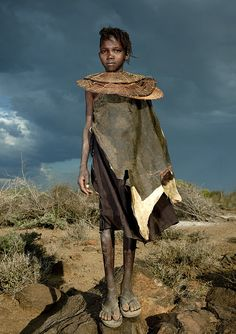 Pokot girl with giant necklace - Kenya She wears leather dress and a necklace of beads cut from the stem of an asparagus tree.