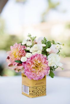wedding flowers in tea tins, photo by Sarina Love Photography http://ruffledblog.com/hilton-san-diego-wedding #weddingideas #centerpieces