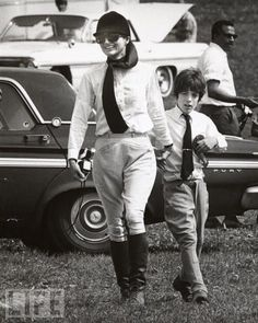 Jackie Kennedy Onassis takes her son John F. Kenendy Jr. to a horse show, 1970.