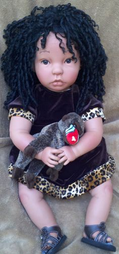 This woman makes beautiful ethnic dolls.  Wish I had one when I was a kid.