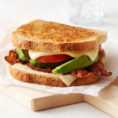 Bacon & Avocado Grilled Cheese Sandwiches Recipe | Land O'Lakes A buttery and toasty grilled cheese sandwich stuffed with cool and creamy guacamole, crispy bacon and melted jack and cheddar cheese. The crunchy crumbled tortilla chips in this grilled cheese pay tribute to the classic combination of tortilla chips and guacamole dip. #Bacon #GuacamoleGrilled #Cheese #Sandwich