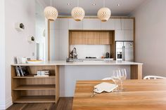 Interior of TV show The Block, NZ, where three pretty David Trubridge BELLE pendant lights line the kitchen. Click image for where to buy or to sign up for our newsletter.