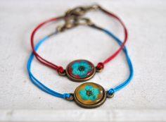 http://de.dawanda.com/product/66825779-Echte-Bluete-Armband---tuerkisochra