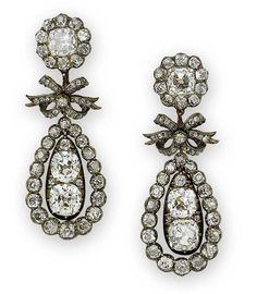 Right pair is slightly misaligned during the photo shoot. - A pair of diamond pendeloque earrings, circa 1810 Each cushion-shaped diamond cluster surmount suspending a diamond-set ribbon bow motif, terminating in a cushion-shaped diamond pendant, within a drop-shaped border of smaller cushion-shaped diamonds, mounted in silver and gold, the smaller diamonds in closed-back settings, diamonds approximately 8.90 carats total, later screw fittings, cased by S J Phillips
