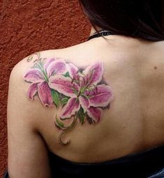 White and pink lilies tattoo...beautiful. Pretty realistic.