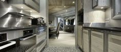 Contemporary Hotel Designs for Your Perfect Holiday: Imposing Chalet Black Pearl Kitchen With Sleek Cabinet With Glossy Countertop And Lights Under Upper Cabinet And Grey Backsplash ~ SFXit Design Hotel Chalet Design, Chalet Style, House Design, Ski Chalet, Design Hotel, Isere France, Chalet Interior, Interior Design, Val D'isère