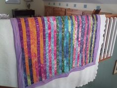 My first jellyroll quilt, done with a purple border.
