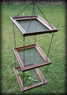 DIY herb drying rack constructed from screens stretched into old picture frames.