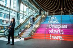 """The Vancouver Convention Center's stairs featured color-blocked sections printed with the conference's tagline, """"The next chapter starts her... Photo: Bret Hartman"""