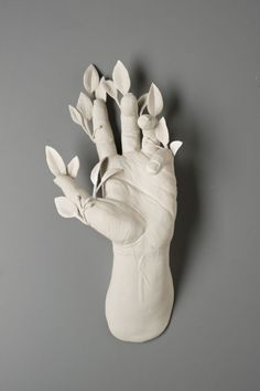 hand and leaves porcelain sculpture by kate macdowell
