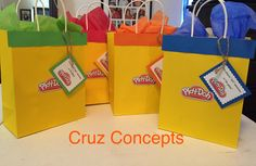 """Game prize bags, you played """"doh"""" awesome in the game. Playdoh theme 5th birthday party decor decoration red yellow white rainbow circles dough game activity banner wall balloons container"""