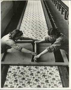 textile industry..these ladies are silk screening the material...I worked for 8 years making silk screens for screen printers on smaller scale ...