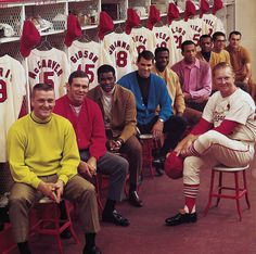 Hall of fame manager Red Schoendienst sits with his team a year after they won the World Series. Bob Gibson (45), Lou Brock (20) and Orlando Cepeda (30) were all a part of the Word Series team and are now in the Hall of Fame. Schoendienst managed five World Series-winning teams.
